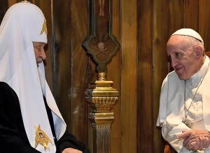 Pope Francis (R) meets with the head of the Russian Orthodox Church, Patriarch Kirill, in Havana on February 12, 2016. Pope Francis and Russian Orthodox Patriarch Kirill kissed each other and sat down together Friday for the first meeting between their two branches of the church in nearly a thousand years. Francis, 79, in white robes and a skullcap and Kirill, 69, in black robes and a white headdress, exchanged kisses and embraced before sitting down smiling for the historic meeting at Havana airport.  AFP PHOTO / GABRIEL BOUYS / AFP / GABRIEL BOUYS