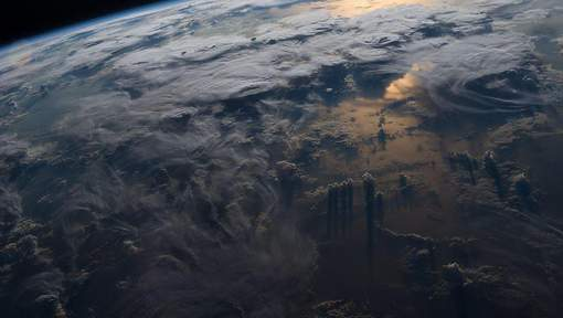 March 28, 2016 - International Space Station, Space - View of clouds, thunderstorms and sunset reflected off the Earth seen from the International Space Station.